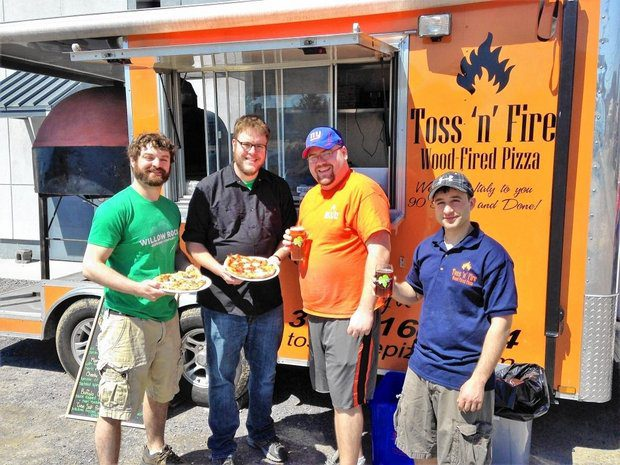 Teaming up craft beer and food trucks: Kevin Williams and Rockney Roberts of Willow Rock Brewing Co. with Charles Cerminaro and Matt Leo from Toss 'n Fire Wood-fired Pizza. Toss 'n Fire sets up frequently on Fridays or Saturdays in the parking lot at Willow Rock, 115 Game Road in Syracuse. (Don Cazentre)